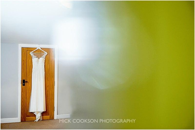 wedding dress hanging up at charnock farm