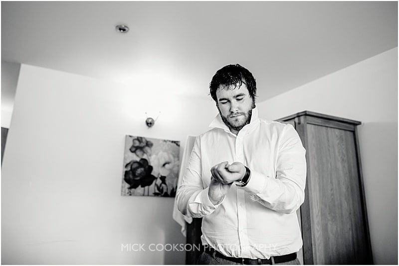 groom getting ready at charnock farm