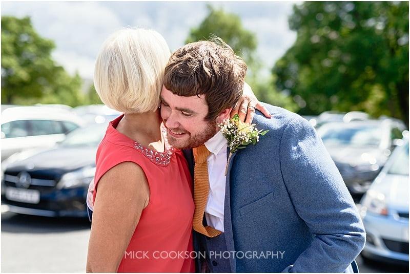 groom gets a hug