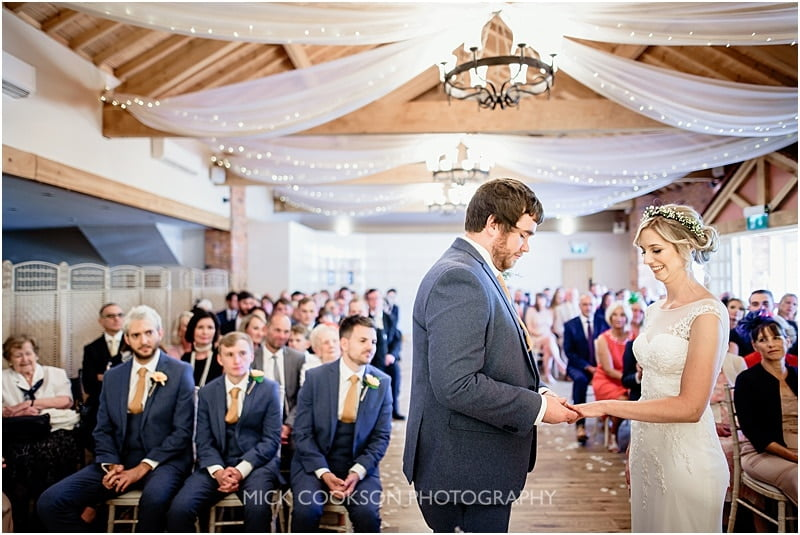 putting on the ring at a charnock farm wedding