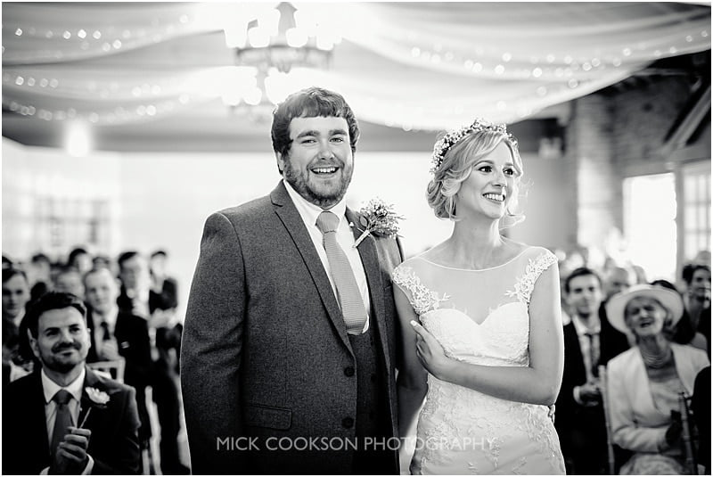 groom smiles at the camera
