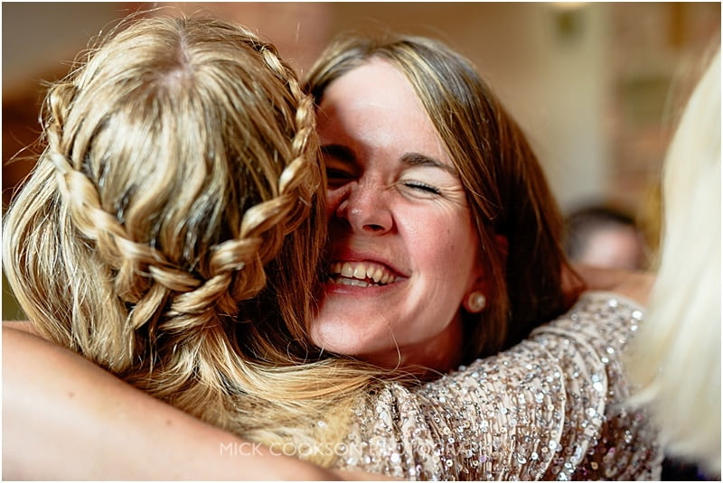 tight hug at a wedding