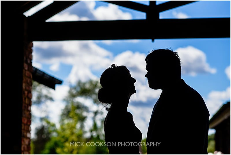 silhouette of the bride and groom at charnock farm