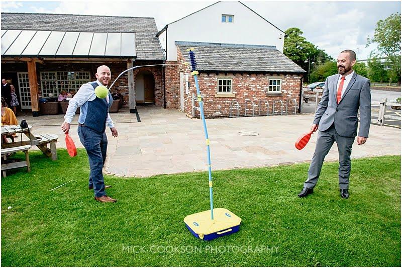 wedding guests playing swingball