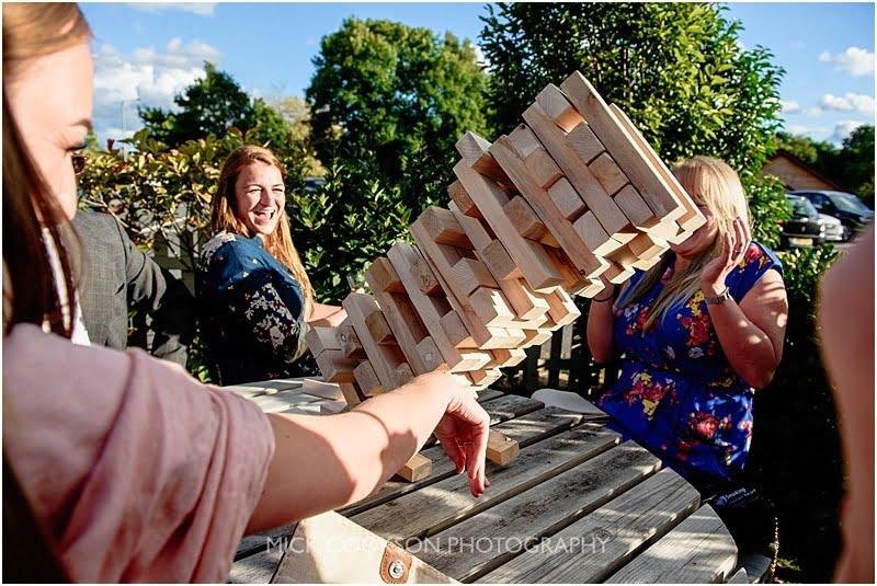 jenga tower collapsing at a charnock farm wedding