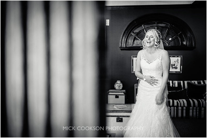 black and white photo of a bride laughing