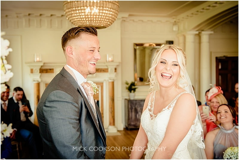 bride and groom laughing during the ceremony at eaves hall