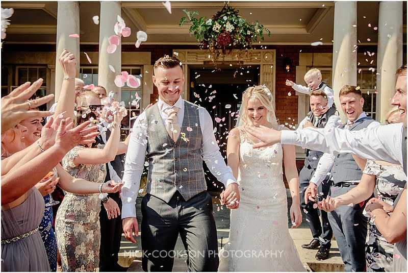 confetti throw at an eaves hall wedding