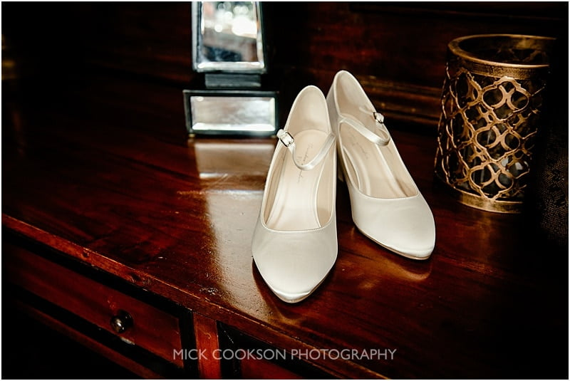 brides shoes at a mitton hall wedding