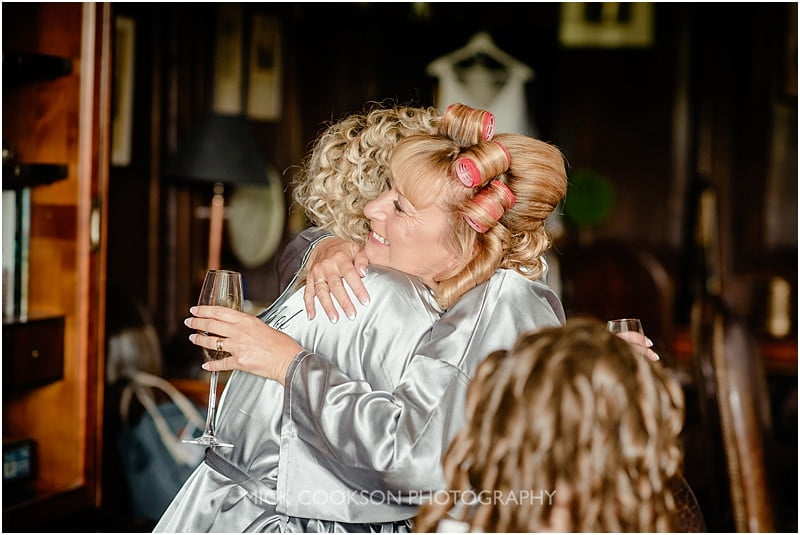 hugs at a mitton hall wedding