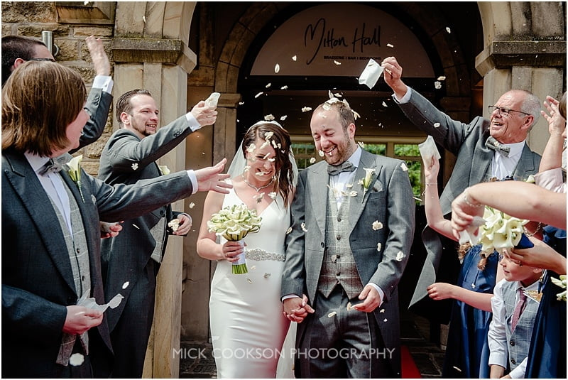 confetti throwing at a mitton hall wedding