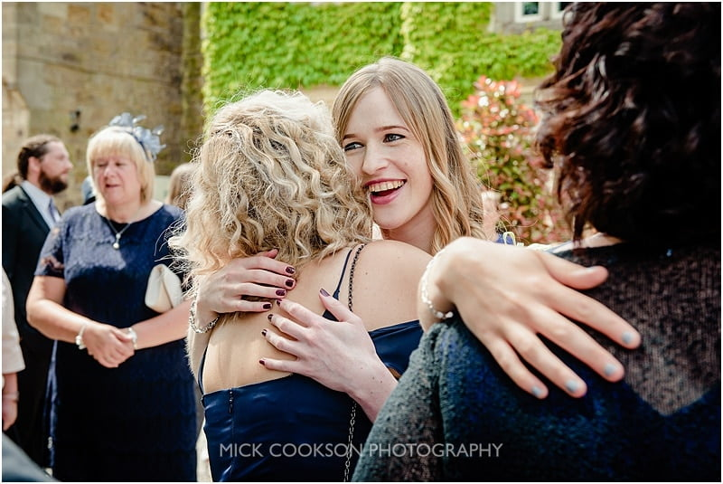 big hugs at a mitton hall wedding