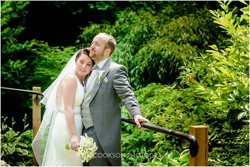 bride and groom share a moment at a mitton hall wedding