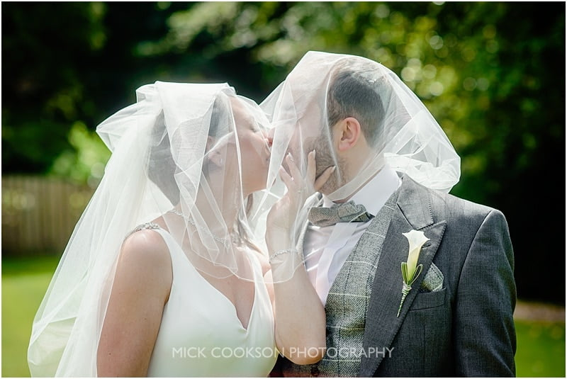 a cheeky kiss under the veil