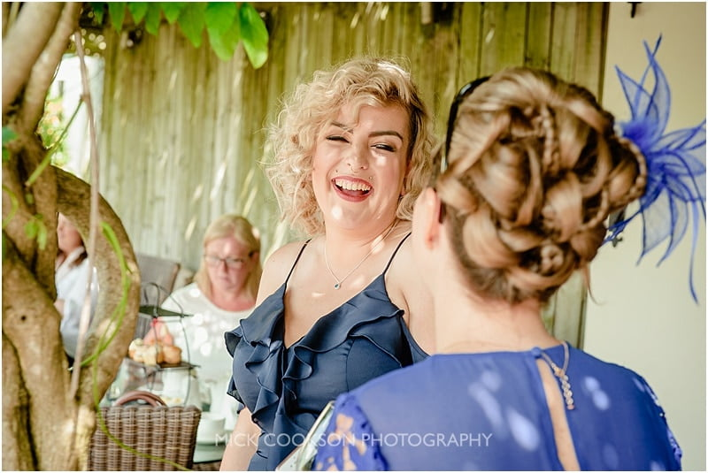 bridesmaid laughing at a mitton hall wedding