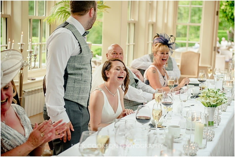 happy bride at her mitton hall wedding