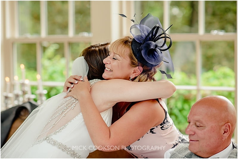 a hug for mum at a mitton hall wedding
