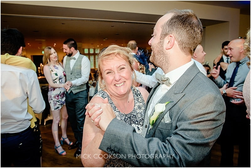 groom and mum dancing at a mitton hall wedding
