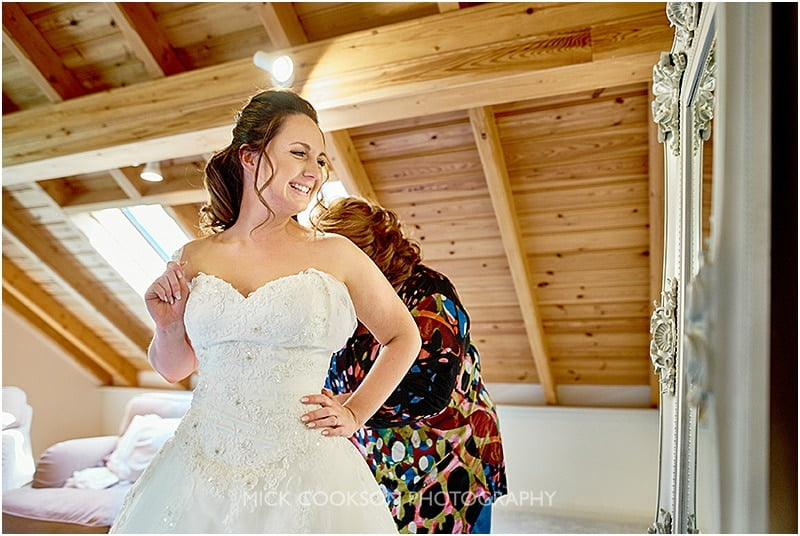 smiling bride getting ready at her oak tree of peover wedding