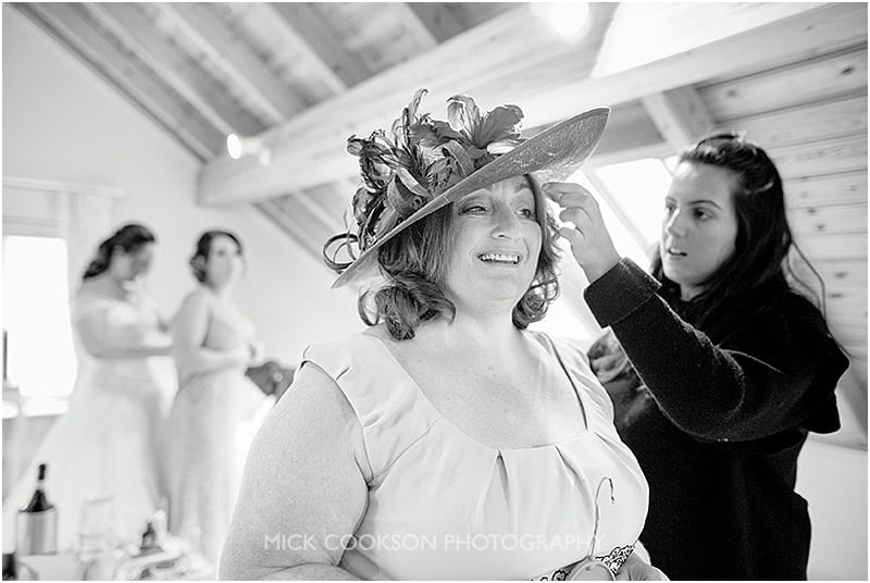 mother of the bride puts her hat on for a wedding