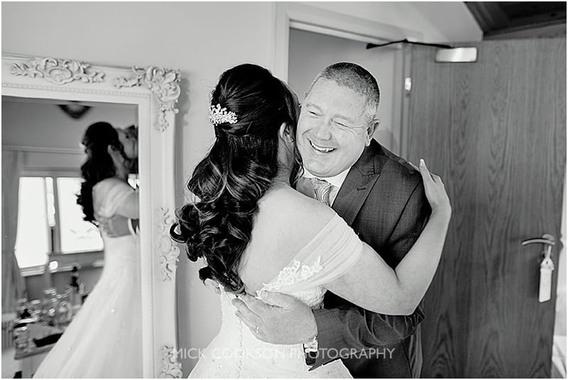 father of the bride hugs his daughter at oan ak tree of peover wedding