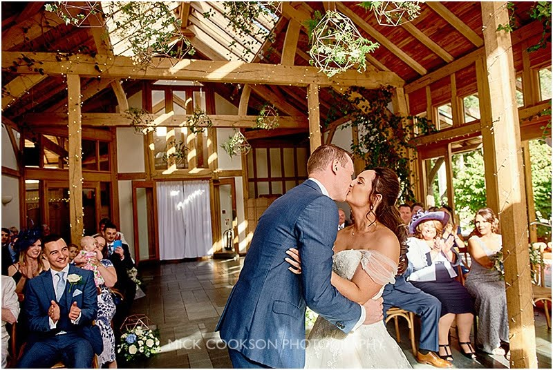 first kiss as man and wife at an oak tree of peover wedding