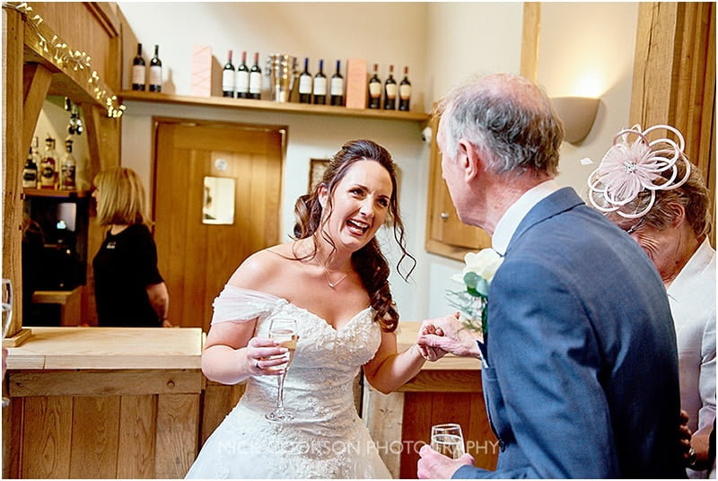 happy bride celebrates at her oak tree of peover wedding