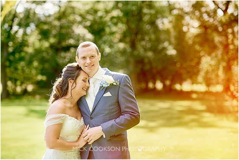 bride and groom at an oak tree of peover wedding