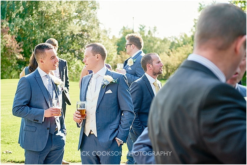 wedding guests at the oak tree of peover