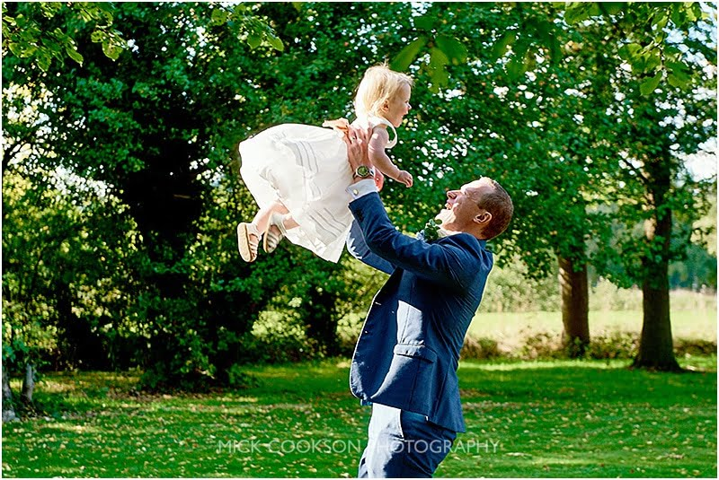dad and daughter having fun at a wedding