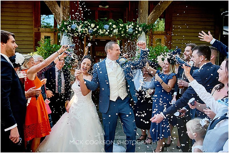 confetti throwing at an oak tree of peover wedding