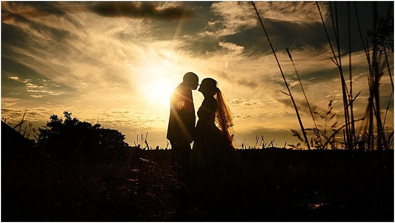 bride and groom wedding photo at sunset at the stables country club taken by manchester wedding photographer mick cookson