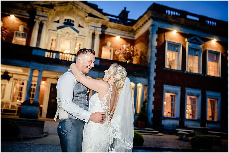 first dance outside eaves hall at this stunning summer wedding taken by manchester wedding photographer mick cookson