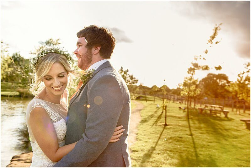 bride and groom wedding photo at their charnock farm wedding taken by manchester wedding photographer mick cookson