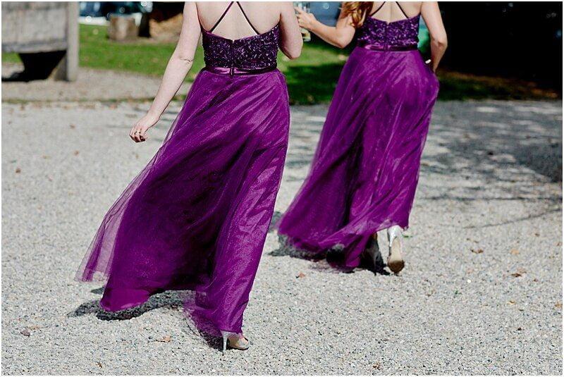 stunning cadburys purple bridesmaids dresses at mitton hall taken by manchester wedding photographer mick cookson