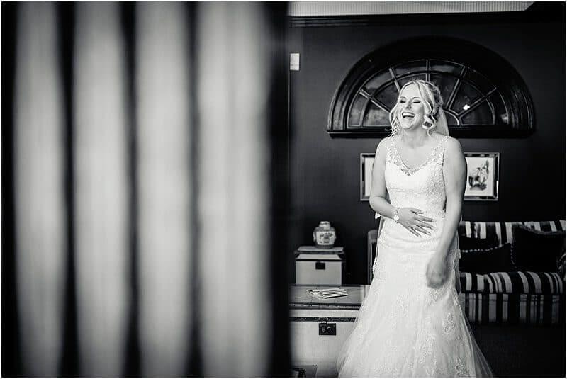 happy bride wedding photo at eaves hall