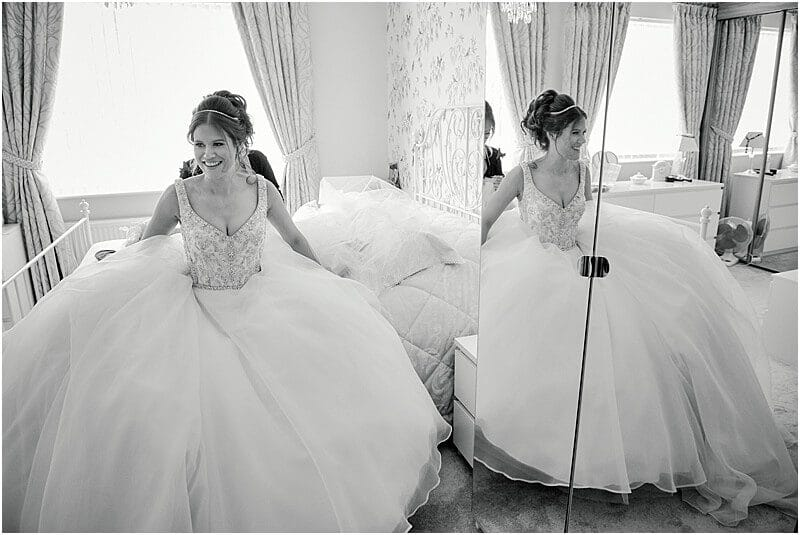 bride reflected in a full length mirror