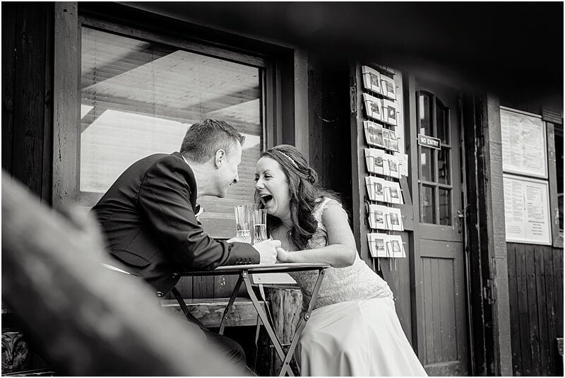 bride and groom laughing wedding photo taken by manchester wedding photographer mick cookson in grasmere cumbria