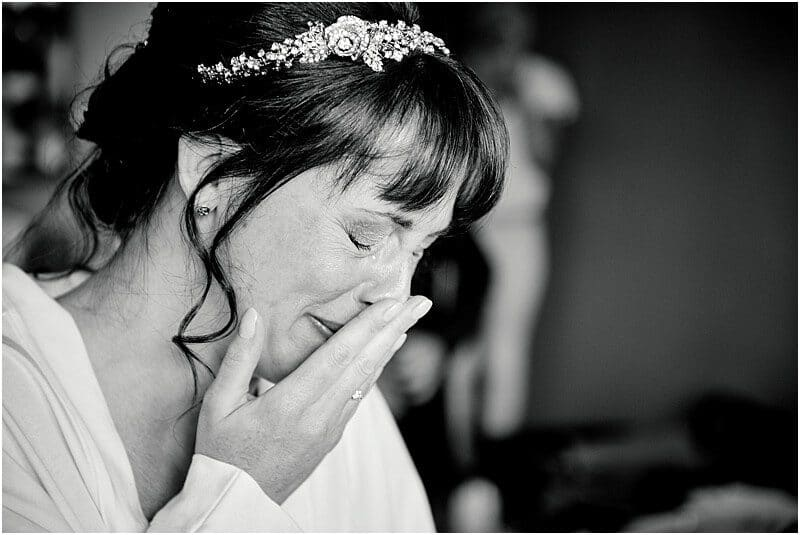 emotional bride at stanley house taken by manchester wedding photographer mick cookson