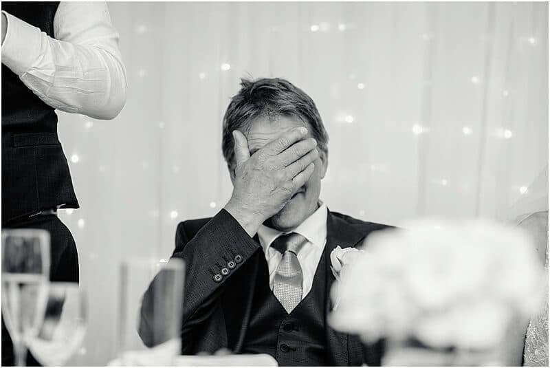 groom face palm at stirk house wedding taken by manchester wedding photographer mick cookson