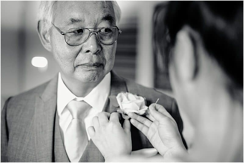 chinese father of the bride getting ready