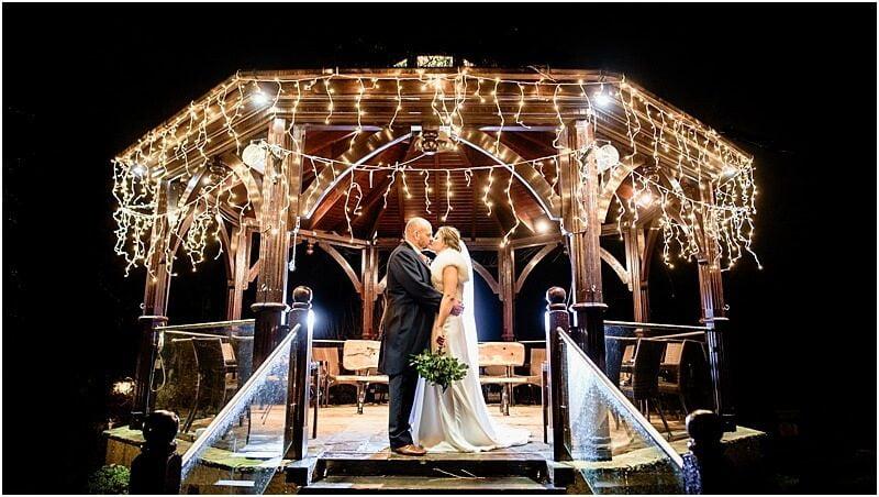 stunning winter wedding photo taken at gibbon bridge by manchester wedding photographer mick cookson