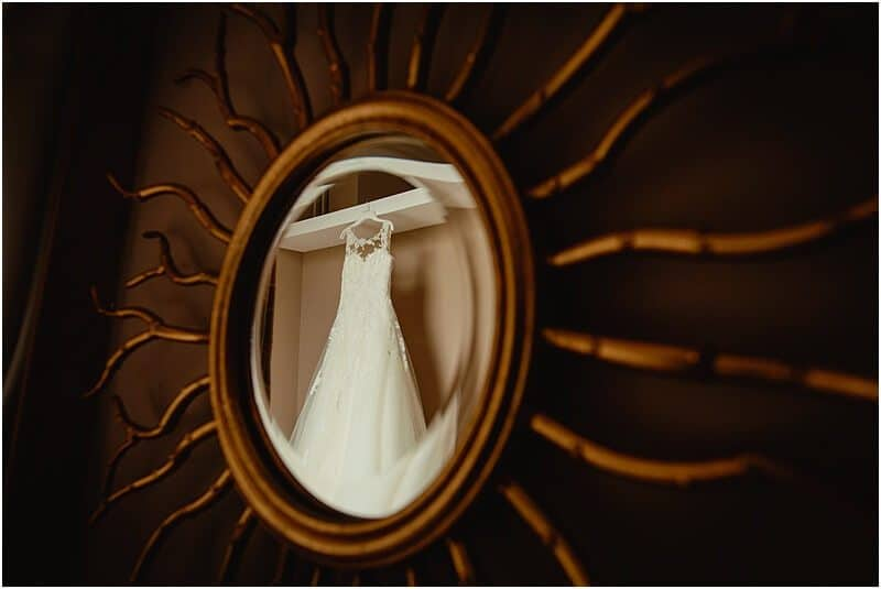 wedding dress reflected in a mirror at a haigh hall wedding taken by manchester wedding photographer mick cookson