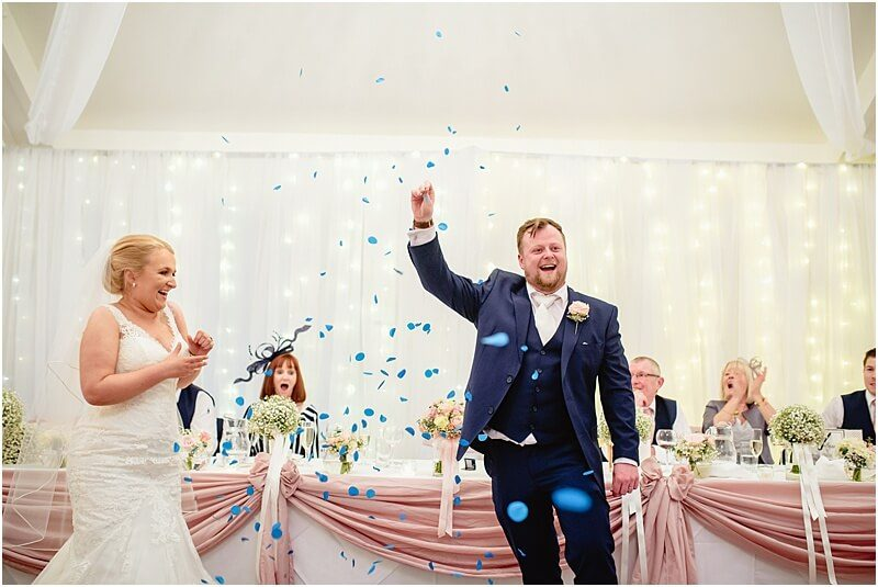 gender reveal photo at the wedding speeches at stanley house taken by manchester wedding photographer mick cookson