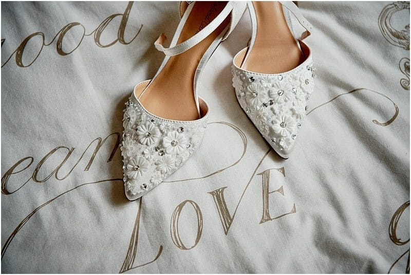 wedding shoes photo taken by manchester wedding photographer mick cookson