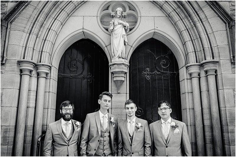 groomsmen standing outside church