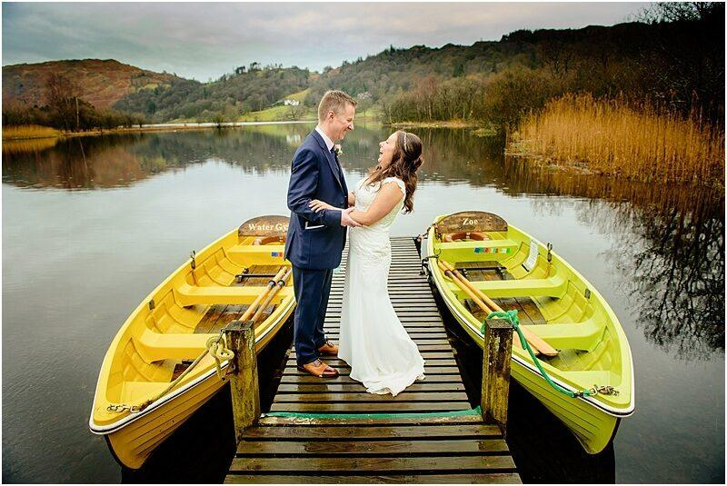 bride and groom having fun in grasmere