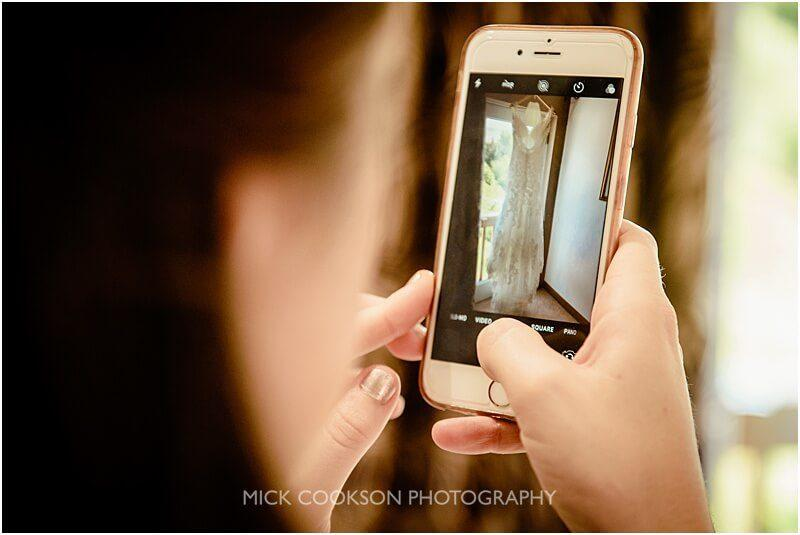 photo of a wedding dress on a mobile phone