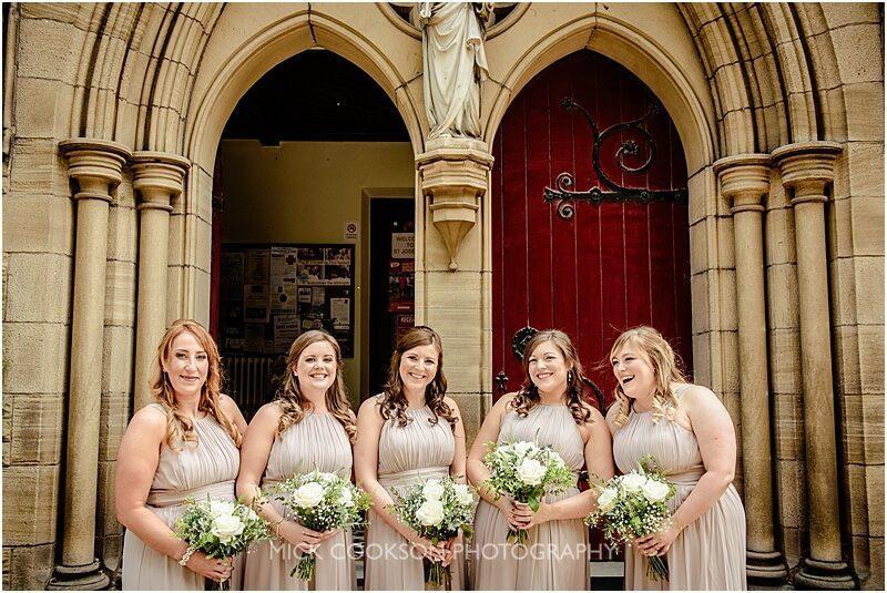 bridesmaids laughing outside church