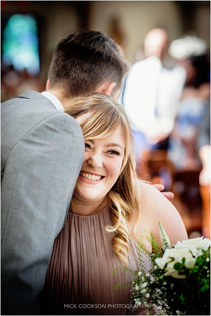groom hugs his sister at his wedding